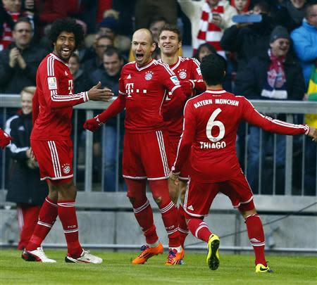 Munich players celebrate during their German first division Bundesliga soccer match against Braunschweig in Munich