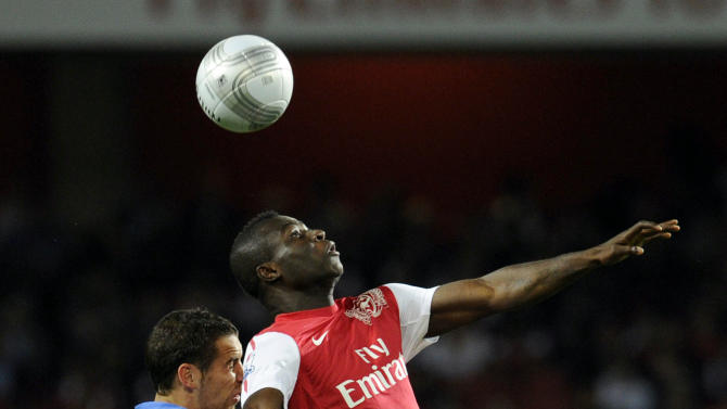 Arsenal's Emmanuel Frimpong, right, beats Shrewsbury Town's Sean McAllister to the ball during their English League Cup soccer match at the Emirates stadium, London, Tuesday, Sept. 20, 2011. (AP Photo/Tom Hevezi)