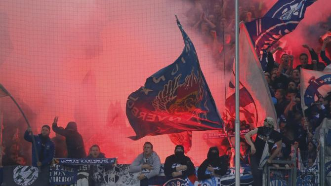 Karlsruhe SC supporters let of flares during their German Bundesliga first leg relegation playoff soccer match against Hamburger SV in Hamburg