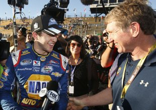 Chase Elliott, 18, celebrates his Nationwide (now Xfinity) championship with his father Bill Elliott. (AP)