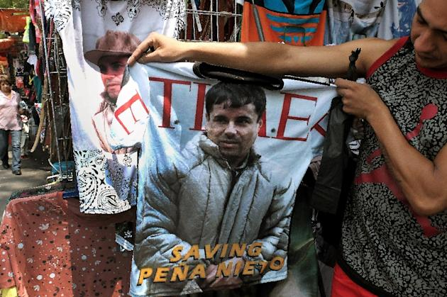 "Police from the Americas to Europe and Australia have joined forces in a ""marathon"" to catch Mexican drug lord Joaquin ""El Chapo"" Guzman, pictured on a t-shirt in Mexico City on July 20, 2015 (AFP Photo/Alfredo Estrella)"