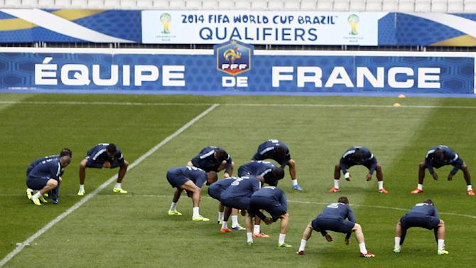 France's soccer team warms up during a training session at the Stade de France stadium in Saint Denis, north of Paris, Monday, Oct. 14, 2013, ahead of their 2014 World Cup Group I qualifying soccer match against Finland