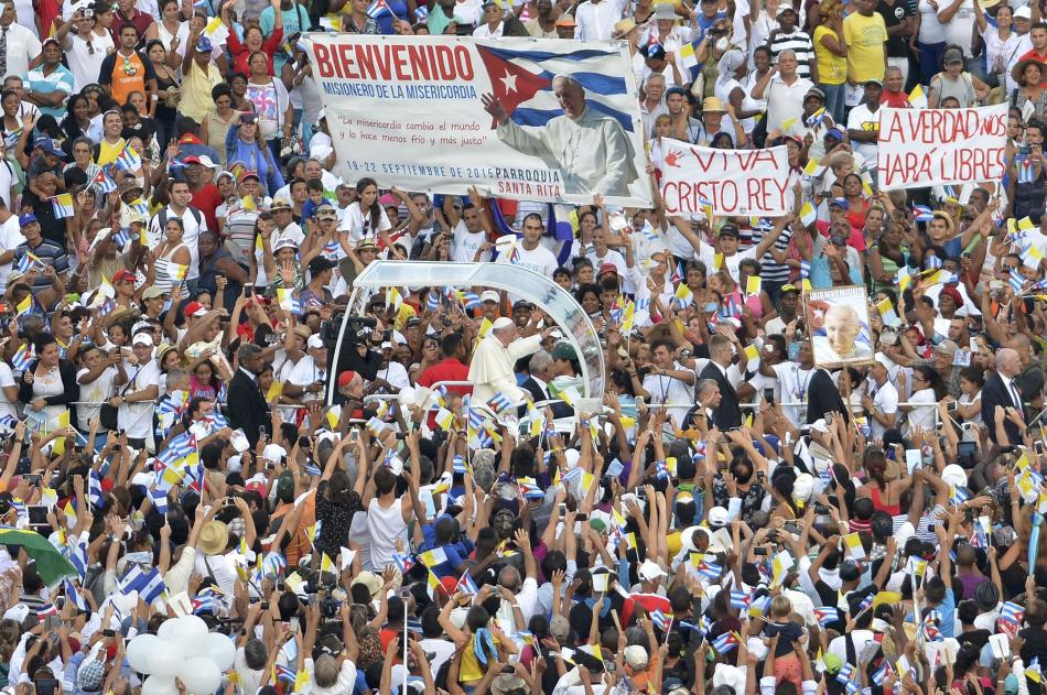 Pope Francis rides past the Catholic faithful after holding the first mass of his visit to Cuba in Havana's Revolution Square