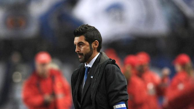 FC Porto's coach Paulo Fonseca walks to his bench prior to a Portuguese League soccer match with Academica at the Municipal Stadium in Coimbra, Portugal, Saturday, Nov. 30, 2013. Academica won 1-0 causing Porto's first defeat in the championship