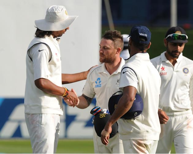 India's Ishant Sharma, left, shakes hands with New Zealand's Brendon McCullum at the end of play as he reached his highest score of 281 on the fourth day of their second cricket test mat at Basin Rese