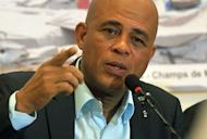 Haitian President Michel Martelly addresses a press conference January 11, 2013 in Port-au-Prince. Three years after Haiti was devastated by a massive earthquake, hundreds of thousands of homeless people are still at risk from crime, disease and the elements in crowded makeshift camps