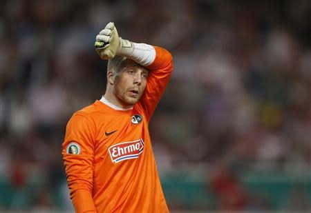 SC Freiburg's goalkeeper Baumann reacts during their German soccer cup (DFB Pokal) semi-final match against VfB Stuttgart in Stuttgart