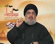 "An image from Hezbollah's Al-Manar TV shows Hezbollah chief Hassan Nasrallah addressing Shiite Muslims gathered for Arbaeen, on January 3, 2013 in Lebanon. War-torn Syria is threatened with ""schemes of division and partition"", Nasrallah said in a televised speech"