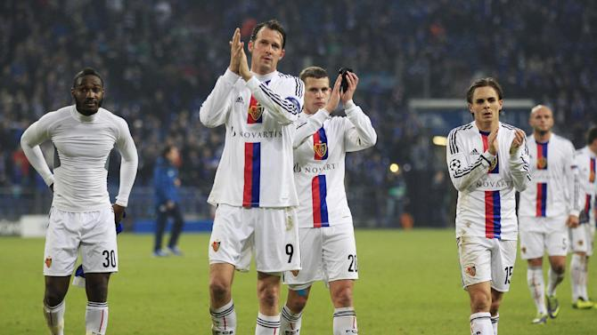 Basel players react after the Champions League group E soccer match between FC Schalke 04 and FC Basel in Gelsenkirchen, Germany, Wednesday, Dec.11,2013