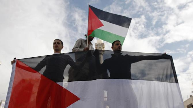 Palestinians celebrate what they call a victory over Israel, in the West Bank city of Ramallah, Thursday, Nov. 22, 2012. Eight days of punishing Israeli airstrikes on Gaza and a barrage of Hamas rocket fire on Israeli ended inconclusively. While Israel claimed in inflicted heavy damage on the militants, Gaza's Hamas rulers claimed that Israel's decision not to send ground troops into the territory, as it had four years ago, was a sign of new-found Hamas deterrence. (AP Photo/Majdi Mohammed)