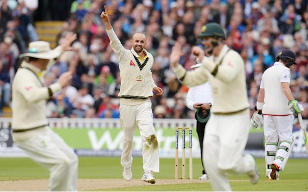Australia's Nathan Lyon celebrates after dismissing England's Alastair Cook