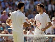 Jul 4, 2014; London, United Kingdom; Grigor Dimitrov (BUL) and Novak Djokovic (SRB) shake hands at the net after their match on day 11 of the 2014 Wimbledon Championships at the All England Lawn and Tennis Club. Susan Mullane-USA TODAY Sports