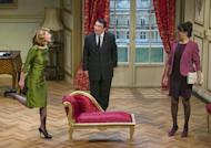 """In this photo taken Tuesday, Feb. 19, 2013, French actors Daniel-Jean Colloredo, center, Marie Piton, left, and Dominique Merot perform in a scene of """"Mr. Normal, His Women and Me,"""" directed by Bernard Uzan, at the Tristan Bernard theater in Paris, France. A vow to keep his private life out of the public eye helped sweep Francois Hollande to power last year as France's president, attracting voters tired of his flashy predecessor's amorous exploits. Now, the words of the one-time dull Socialist are back to bite him in a new play. (AP Photo/Jacques Brinon)"""