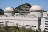 The third and fourth reactor buildings of the Oi nuclear power plant in Fukui prefecture, western Japan. Japan's prime minister is set to defy fierce public sentiment this weekend and order nuclear reactors back online for the first time since Fukushima, as he seeks to head off a summer energy crunch