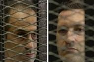 A combo taken off Egyptian state TV shows ousted Egyptian president Hosni Mubarak's sons Gamal (left) and Alaa listening to the verdict in their father's trial at a court in Cairo on June 2, 2012. Swiss authorities have frozen $300 million (227 million euros) sitting in Credit Suisse accounts in Geneva held by the sons of deposed Egyptian president Hosni Mubarak, according to a Swiss newspaper
