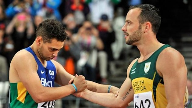 South Africa's Oscar Pistorius (R) shakes hands with Brazil's Alan Fonteles Cardoso Oliveira (L) after competing in the Men's 200m T44 Final athletics event during the London 2012 Paralympic Games (AFP)