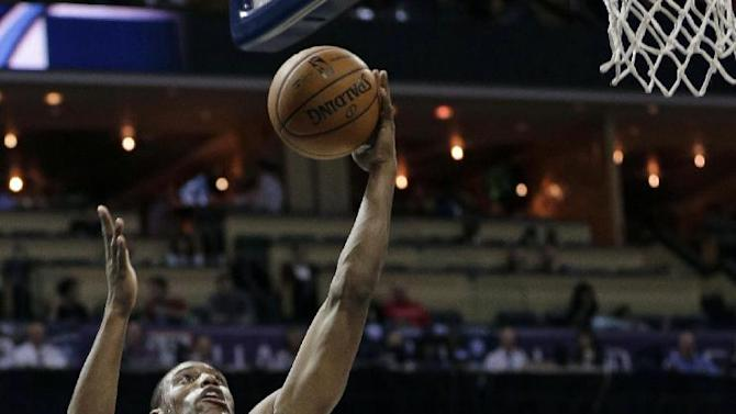 Philadelphia 76ers' Thaddeus Young (21) drives against Charlotte Bobcats' Cody Zeller during the second half of an NBA basketball game in Charlotte, N.C., Friday, Dec. 6, 2013. The Bobcats won 105-88
