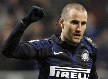 Inter Milan's Rodrigo Palacio celebrates after scoring against AC Milan during their Italian Serie A soccer match at San Siro stadium in Milan December 22, 2013. REUTERS/Alessandro Garofalo/Files