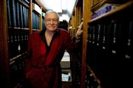 In this Oct. 13, 2011 photo, American magazine publisher, founder and Chief Creative Officer of Playboy Enterprises, Hugh Hefner poses for a photograph at his home at the Playboy Mansion in Beverly Hills, Calif. (AP Photo/Kristian Dowling)