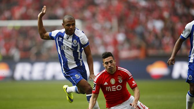 Benfica's Nicolas Gaitan is tackled by Porto's Yacine Brahimi during their Portuguese premier league soccer match at Luz stadium in Lisbon