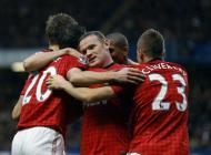 Manchester United's players, Wayne Rooney, centre, celebrate, after Chelsea scored an own goal, during their English Premier League soccer match, at Stamford Bridge Stadium in London, Sunday, Oct. 28, 2012. (AP Photo/Kirsty Wigglesworth)