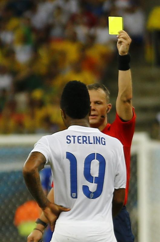 England's Sterling receives a yellow card from referee Bjorn Kuipers of the Netherlands during their 2014 World Cup Group D soccer match against...
