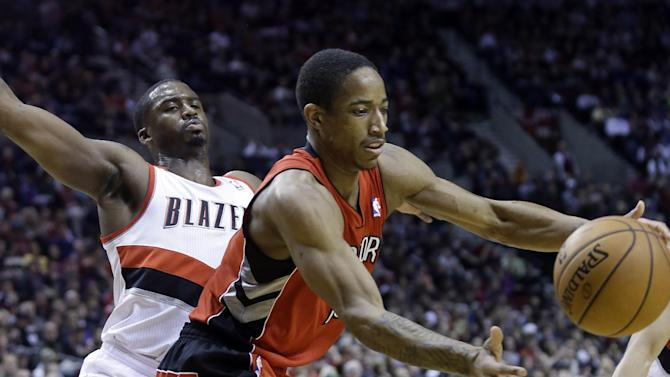 Toronto Raptors guard DeMar DeRozan, right, pulls in a loose ball as Portland Trail Blazers guard Wesley Matthews defends during the first half of an NBA basketball game in Portland, Ore., Saturday, Feb. 1, 2014