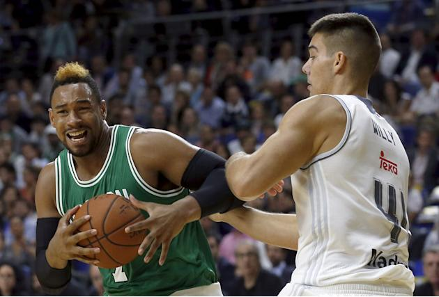 Boston Celtics' Sullinger goes up for a basket over Real Madrid's Hernangomez during their NBA Global Games friendly basketball game in Madrid