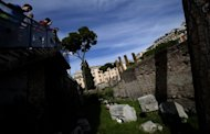 Tourists look down at the ancient Area Sacra ruins in Rome in October 2012. French and Italian archaeologists have found the remains of a grain port that played a critical role in the rise of ancient Rome, France's National Centre for Scientific Research (CNRS) said on Thursday