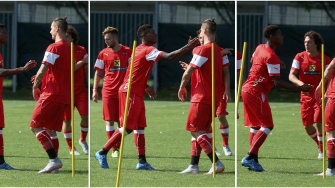 A combination of photos shows Austrian soccer team forwards Alaba and Arnautovic as they joke during a team training session in Vienna