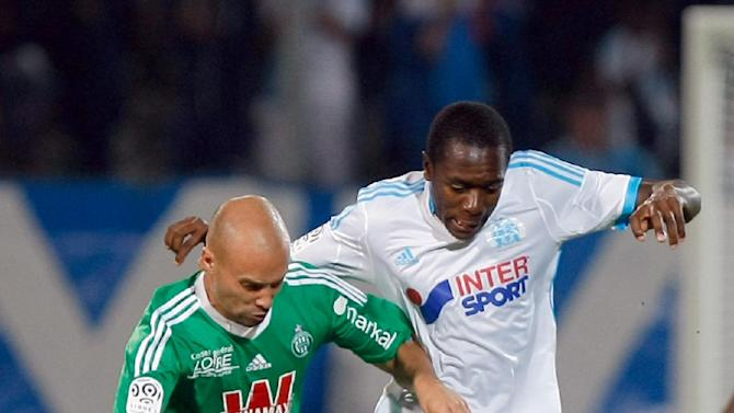 Marseille's French midfielder Giannelli Imbula, right, challenges for the ball with Saint-Etienne's French midfielder Fabien Lemoine during their League One soccer match at the Velodrome Stadium, in Marseille, southern France, Tuesday, Sept. 24, 2013