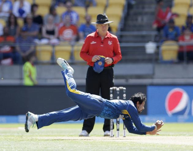 Sri Lanka's Dilshan dives to take the wicket of England's Ballance caught and bowled during their Cricket World Cup match in Wellington