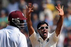 Darren Sammy (L) looks on as Ashwin (R) celebrates taking the wicket of Kieran Powell during fifth day of the third Test between India and the West In...