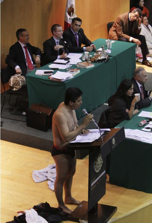 Antonio Garcia of the PRD addresses the audience after stripping down to his underwear during his speech in Mexico City