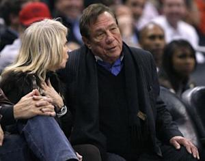 Clippers owner Sterling sits with companion as he watches team play Knicks in NBA game in Los Angeles