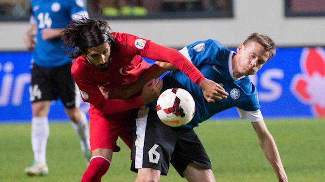 Estonia's Aleksandr Dmitrijev, right,  fights for the ball with Turkey's player during their World Cup Group D qualifying soccer match in Tallinn, Estonia, Friday, Oct. 11, 2013