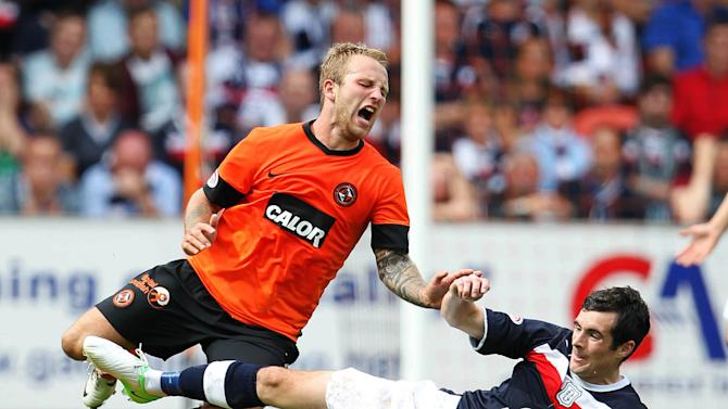 Johnny Russell, left, reacted to a bad challenge from Stephen O'Donnell to earn a dismissal