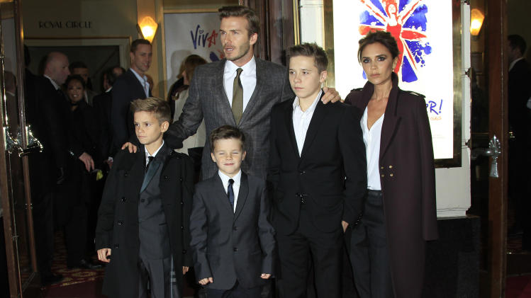 The Beckham family arrive for Viva Forever! Press Night, a musical based on the songs of the Spice Girls, at the Piccadilly Theatre in central London, Tuesday, Dec. 11, 2012. (Photo by Joel Ryan/Invision/AP)