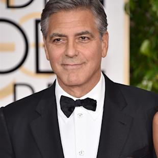 "George Clooney wears a buttong reading ""Je suis Charlie"" at the 72nd annual Golden Globe Awards at the Beverly Hilton Hotel on Sunday, Jan. 11, 2015, in Beverly Hills, Calif. (Photo by John Shearer/Invision/AP)"