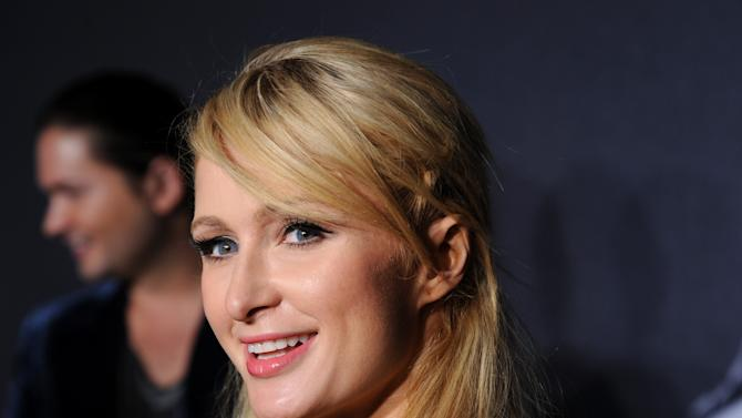 """FILE - In this Sept. 13, 2012 file photo, television personality Paris Hilton arrives at a """"Lady Gaga Fame"""" fragrance launch event at the Guggenheim Museum in New York. Roy Lopez Jr. pleaded no contest to receiving jewelry stolen from Hilton's home and was sentenced to three years of supervised probation on Thursday Nov. 8, 2012.  (Photo by Evan Agostini/Invision/AP, File)"""