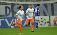 Montpellier's Karim Ait-Fana (L) and Younes Belhanda celebrate scoring a goal during their UEFA Champions League Group B match against Schalke 04 in Gelsenkirchen, western Germany. The match ended in a 2-2 draw