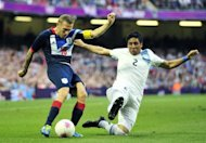 Craig Bellamy (left) clashes with Uruguay's defender Ramon Arias during an Olympic Games clash at the Millennium Stadium in Cardiff on August 1. The Liverpool forward Bellamy has completed an emotional return to his hometown club Cardiff after signing a two-year contract with the Championship outfit on Friday