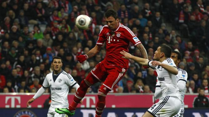 Bayern Munich's Mandzukic scores goal during German Bundesliga first division soccer match against Schalke 04 in Munich