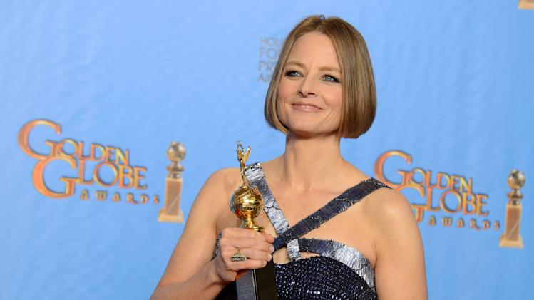 Jodie Foster poses with the Cecile B. DeMille Award for outstanding contribution to the entertainment field backstage at the 70th Annual Golden Globe Awards at the Beverly Hilton Hotel on Sunday Jan. 13, 2013, in Beverly Hills, Calif. (Photo by Jordan Strauss/Invision/AP)