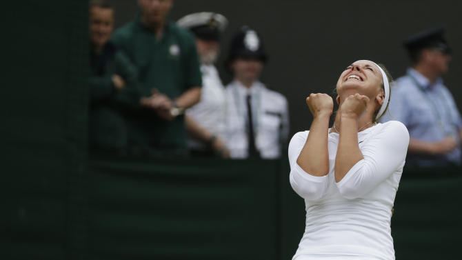 Sabine Lisicki of Germany reacts winning against Maria Sharapova of Russia during a fourth round single match at the All England Lawn Tennis Championships at Wimbledon, England, Monday, July 2, 2012. (AP Photo/Sang Tan)