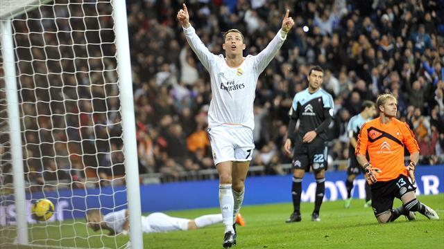 Liga - Ronaldo hits milestone as Real labour to beat Celta