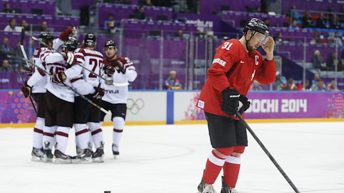 Latvia holds off Swiss 3-1 to reach quarterfinals