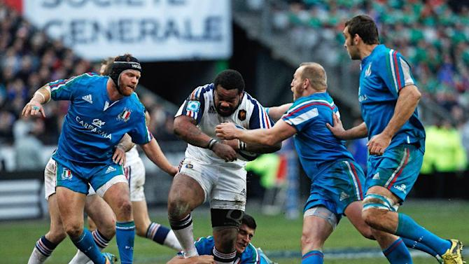 France's Mathieu Bastareaud, center, runs with the ball, during his Six Nations rugby union international match against Italy, at the Stade de France, in Saint Denis, outside Paris, Sunday, Feb 9, 2014. (AP Photo/Thibault Camus)