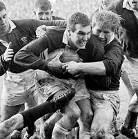 Brian Thomas (centre, with ball) has passed away at the age of 72