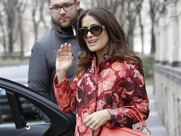 Mexican actress Salma Hayek leaves the Giamba women's Fall-Winter 2015-2016 collection, part of the Milan Fashion Week, unveiled in Milan, Italy, Friday, Feb. 27, 2015. (AP Photo/Antonio Calanni)